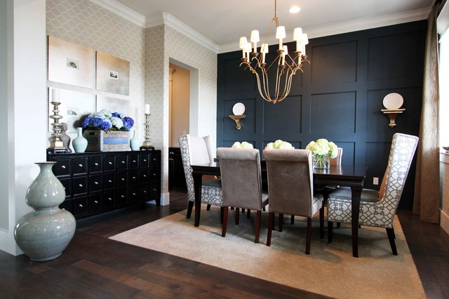 Inspiration for a large contemporary dark wood floor and brown floor enclosed dining room remodel in Orange County with black walls