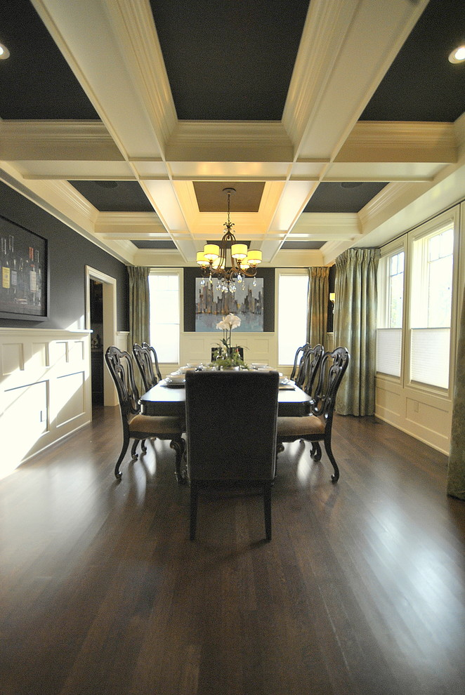 Inspiration for a timeless dark wood floor and brown floor dining room remodel in Edmonton with black walls