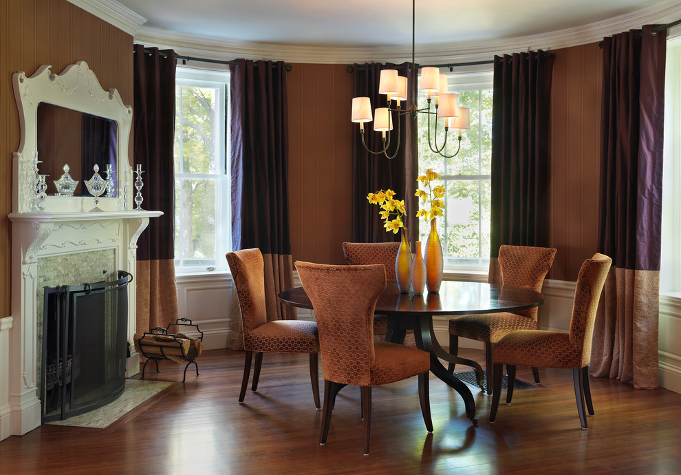 Inspiration for a timeless dark wood floor dining room remodel in Boston with a standard fireplace