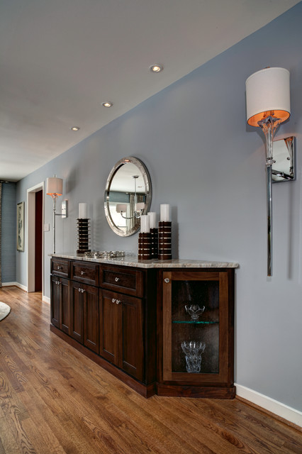 Large eclectic medium tone wood floor great room photo in DC Metro with blue walls and no fireplace