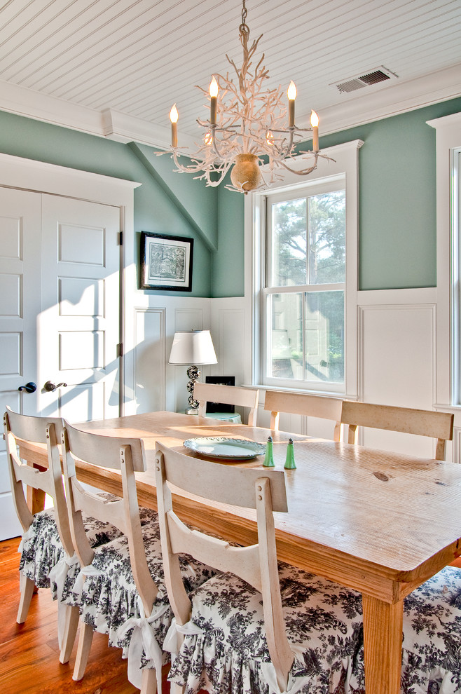 Inspiration for a cottage dark wood floor enclosed dining room remodel in Charleston with blue walls