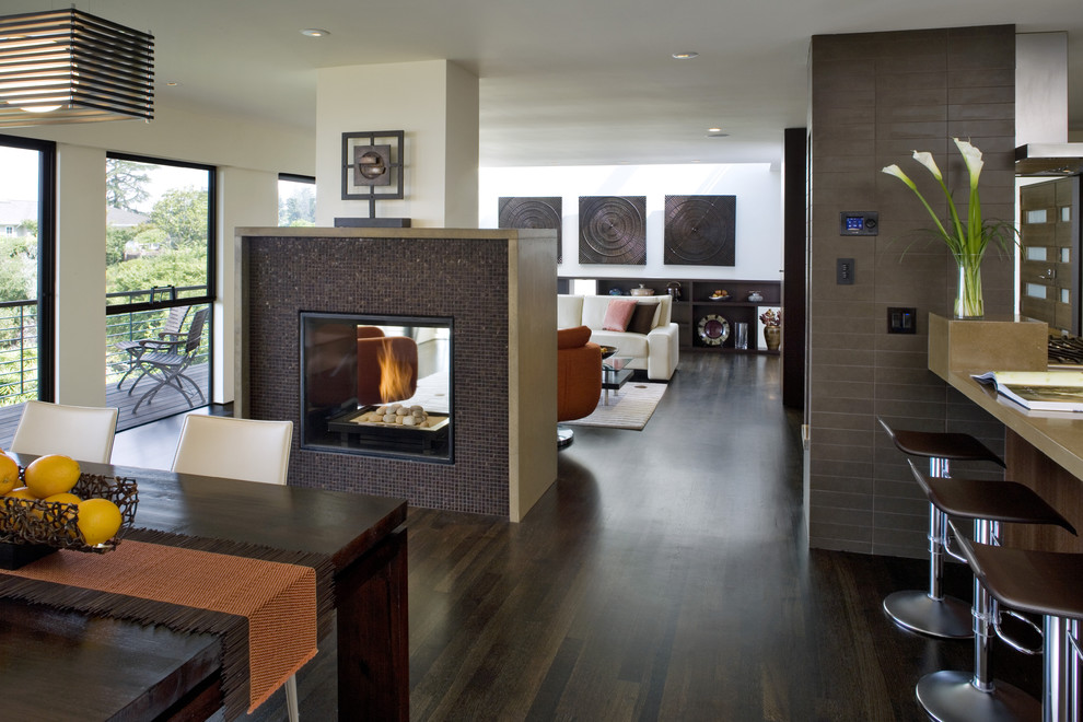 Inspiration for a contemporary great room remodel in San Francisco with a tile fireplace and a two-sided fireplace
