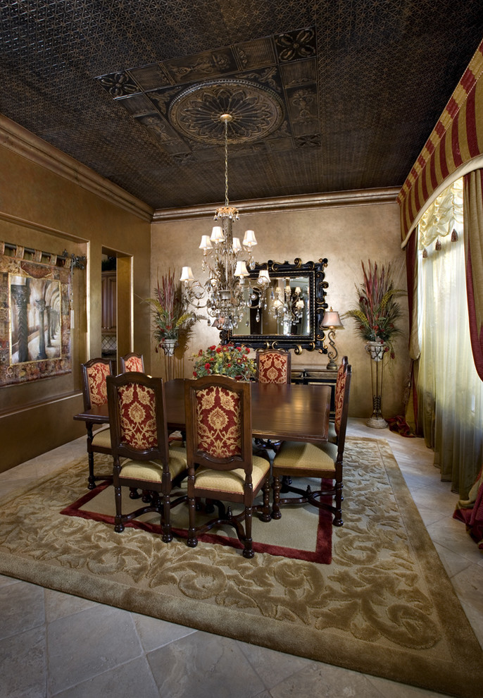 Inspiration for a mediterranean enclosed dining room remodel in Phoenix with brown walls