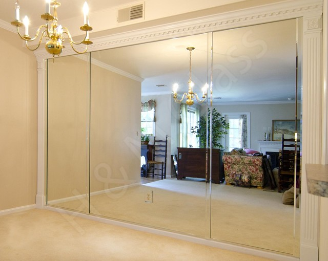 Dining room wall of mirrors in oakmont traditional for Dining room mirrors