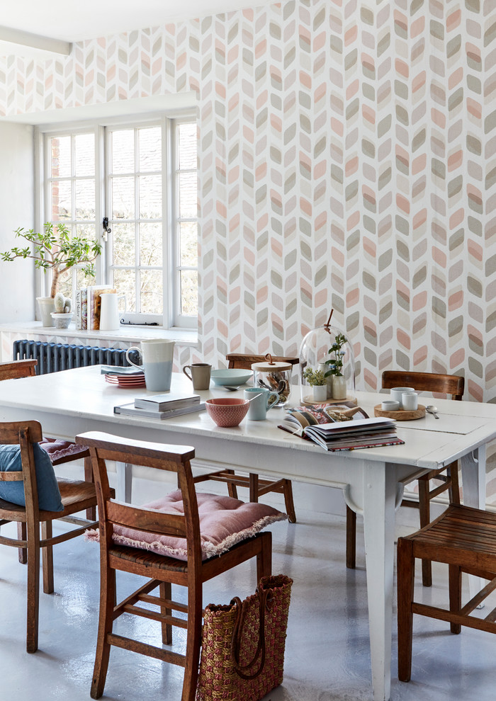 Example of a country dining room design in Sussex with multicolored walls