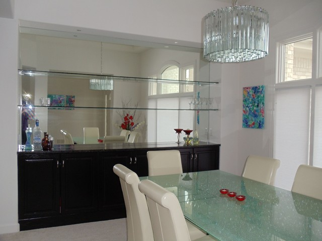 room with mirrored niche to create a home bar contemporary dining room