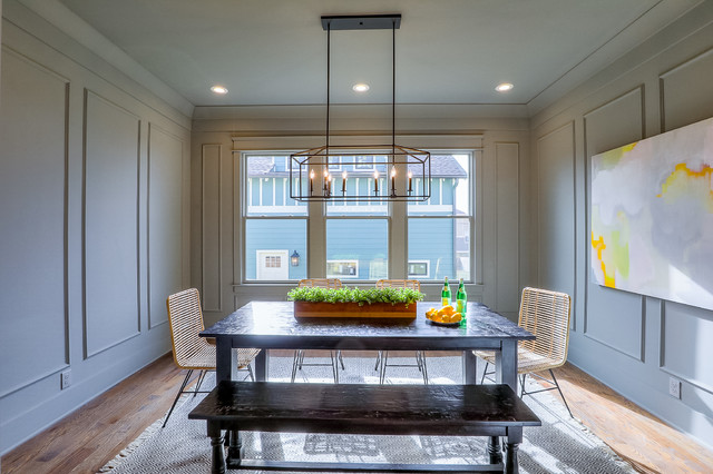 Inspiration for a small craftsman medium tone wood floor and brown floor enclosed dining room remodel in Nashville with gray walls