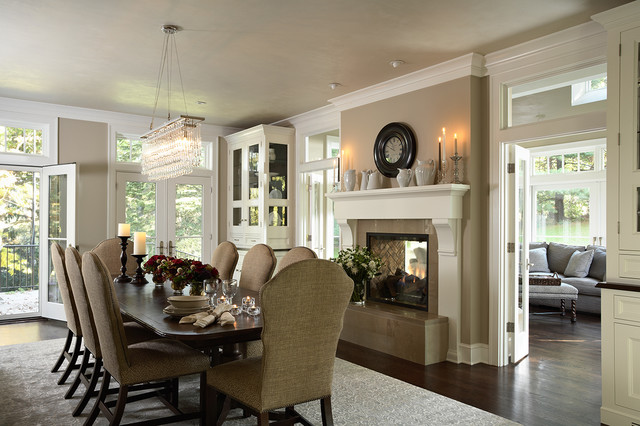 Dining Room With Renovated Two Sided Fireplace Into Porch Traditional