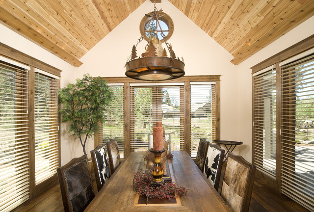 """Dining room with """"specialty lighting"""" rustic-dining-room"""
