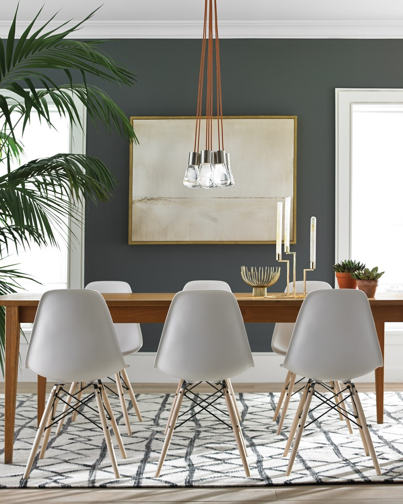 Example of a trendy light wood floor dining room design in Montreal with gray walls
