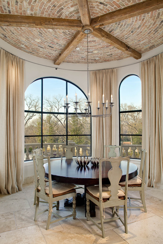 Inspiration for a timeless dining room remodel in Dallas with white walls