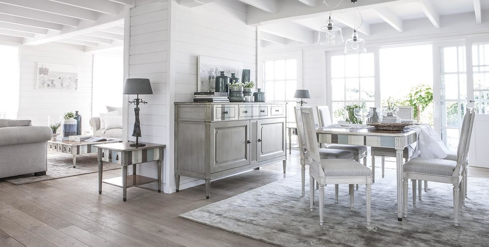 Mid-sized danish light wood floor and beige floor kitchen/dining room combo photo in Kansas City with white walls and no fireplace