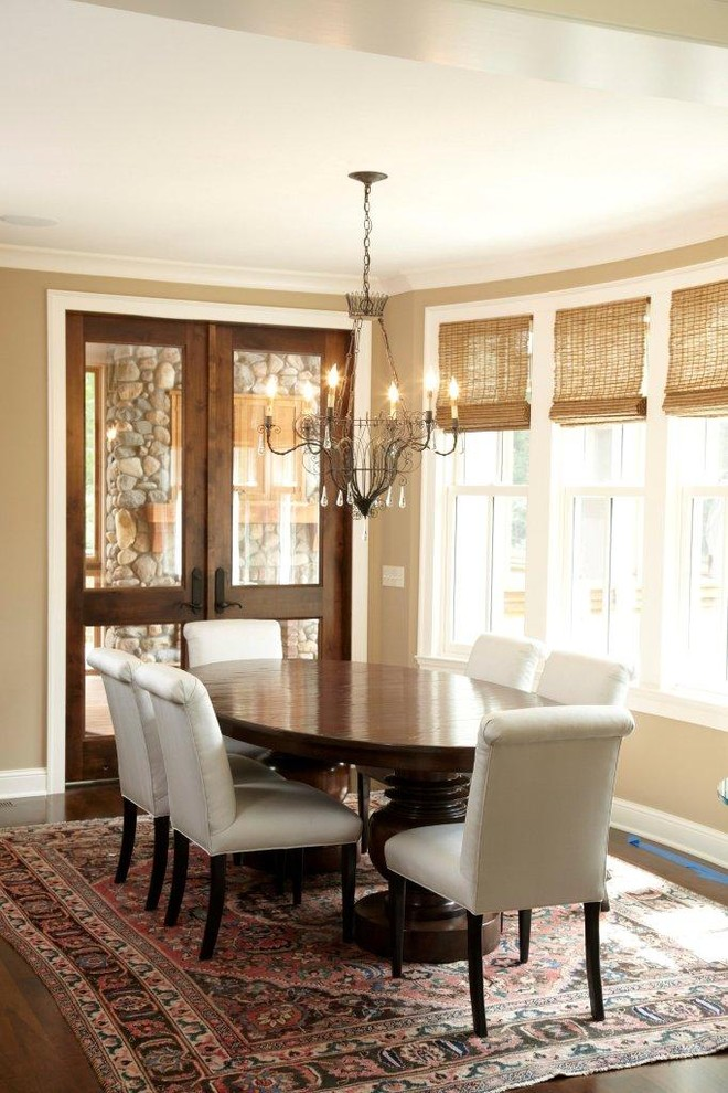 Inspiration for a timeless dark wood floor dining room remodel in Minneapolis with beige walls