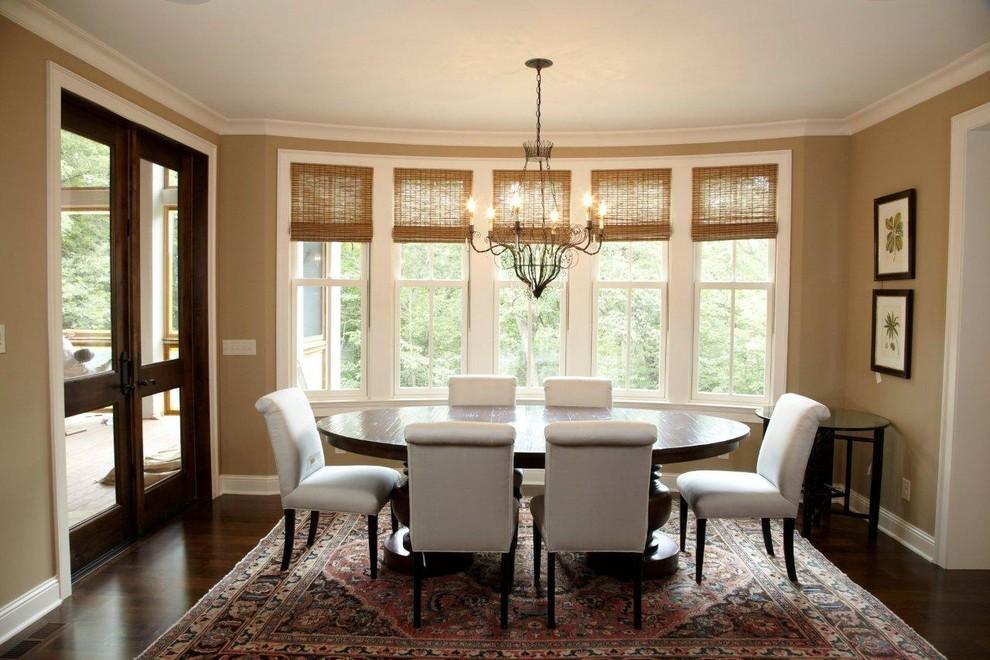 Dining room - traditional dark wood floor dining room idea in Minneapolis with beige walls