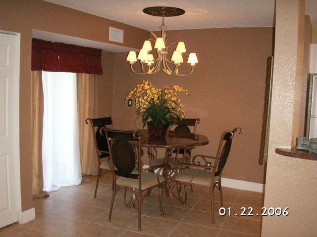 Dining table tropical dining room tampa by for Tropical dining room