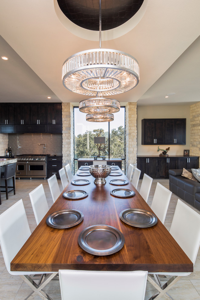 Inspiration for a contemporary dining room remodel in Austin with beige walls