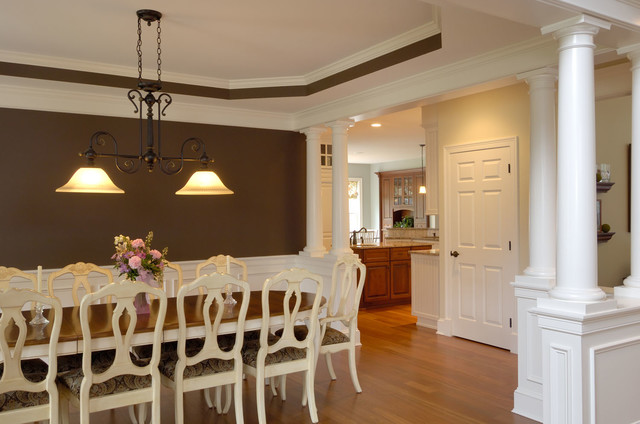 Example Of A Large Classic Light Wood Floor Enclosed Dining Room Design In  Boston With Brown