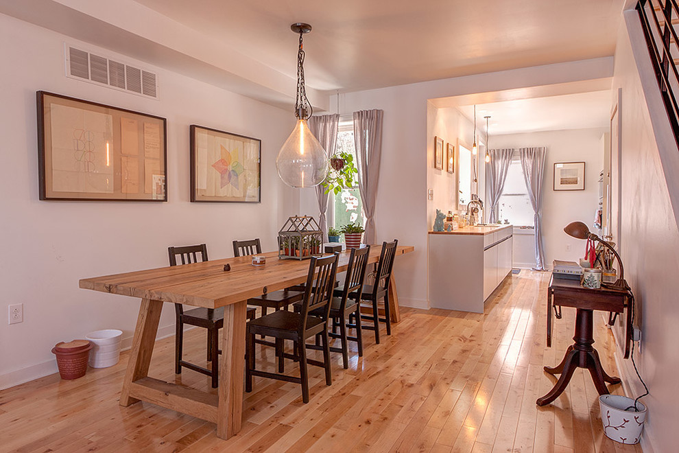 Example of a small urban light wood floor kitchen/dining room combo design in Philadelphia with white walls
