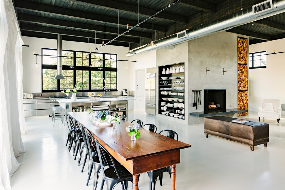 Great room - industrial white floor great room idea in Portland with beige walls
