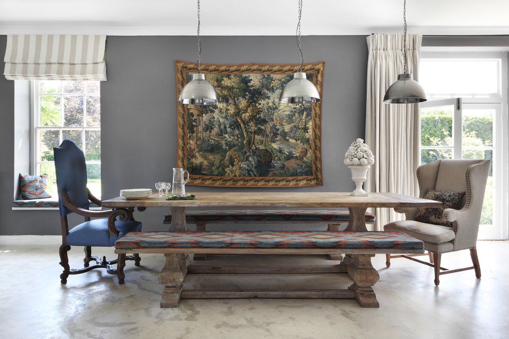 Dining room - french country dining room idea in Dorset with gray walls