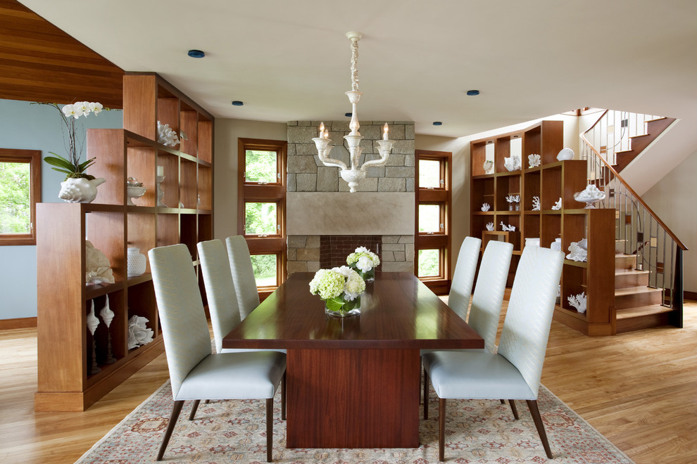 Dining room - contemporary dining room idea in Boston with a stone fireplace