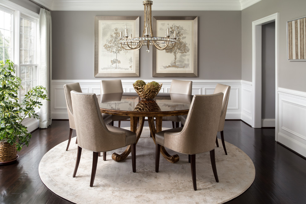 Example of a mid-sized transitional dark wood floor and brown floor enclosed dining room design in DC Metro with gray walls