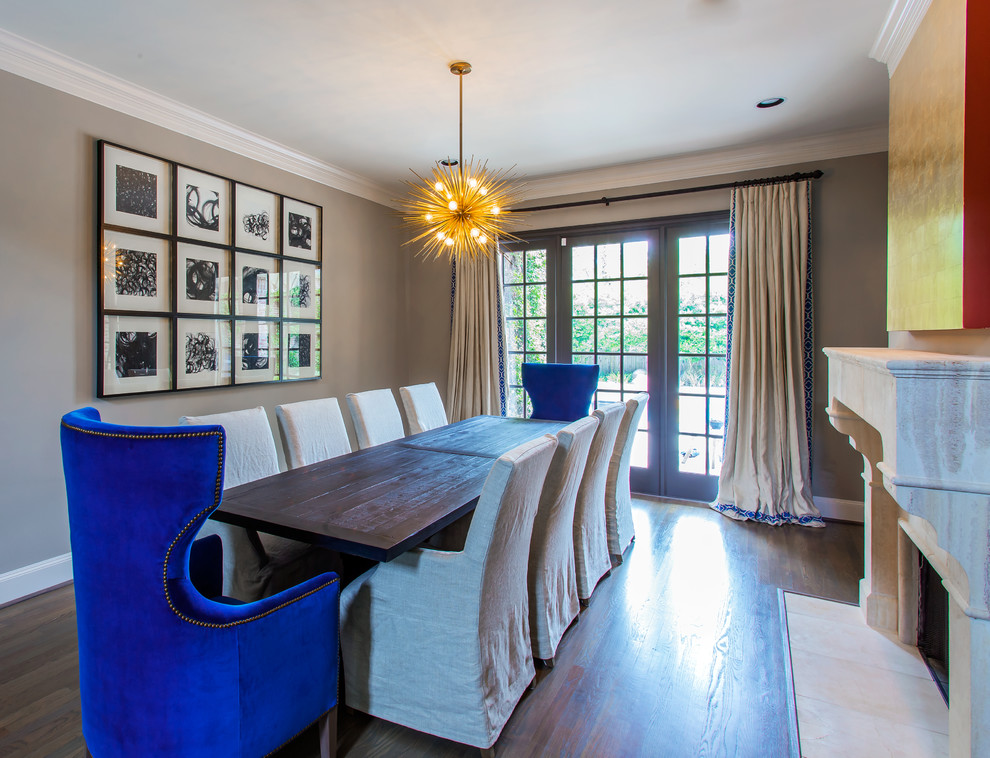 Example of a large eclectic medium tone wood floor great room design in Houston with gray walls, a standard fireplace and a plaster fireplace