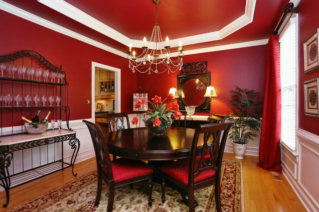 Dramatic red dining room traditional dining room for Traditional red dining room