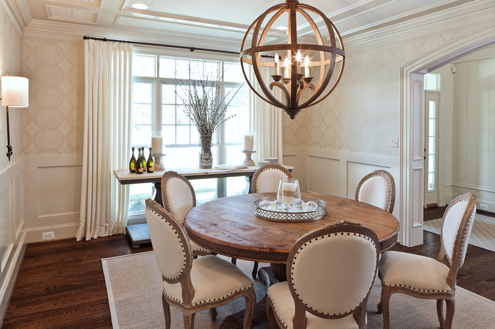 Inspiration for a transitional dark wood floor and brown floor enclosed dining room remodel in DC Metro with beige walls