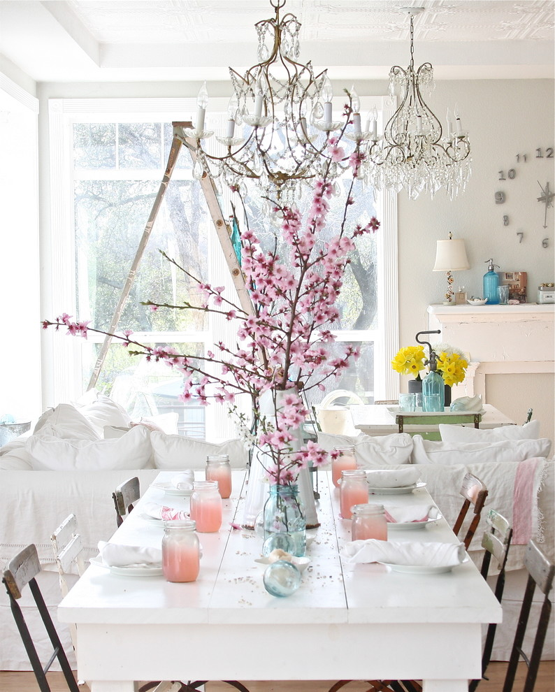 Example of a cottage chic dining room design in Other with white walls