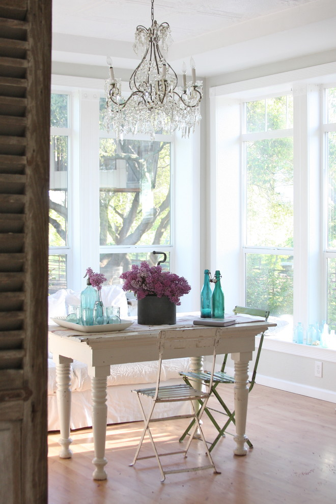 Inspiration for a shabby-chic style medium tone wood floor dining room remodel in Other with beige walls