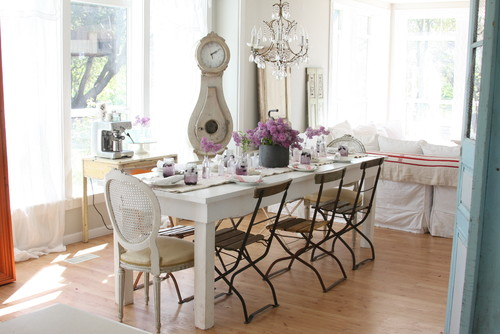 In this article, we'll go over Shabby Chic design and our favorite Shabby  Chic style chandeliers for the dining room.