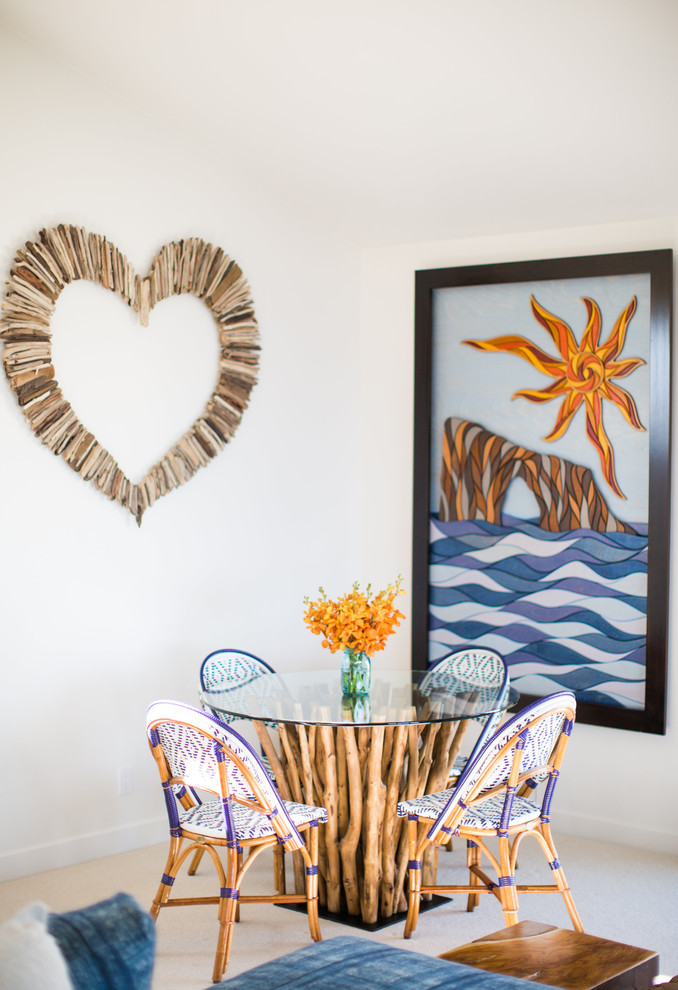Example of a beach style carpeted dining room design in Santa Barbara with white walls