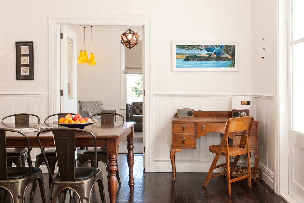 Example of a transitional dark wood floor kitchen/dining room combo design in Auckland with white walls