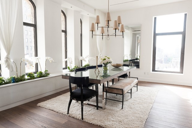 Example of a trendy dark wood floor dining room design in New York with white walls