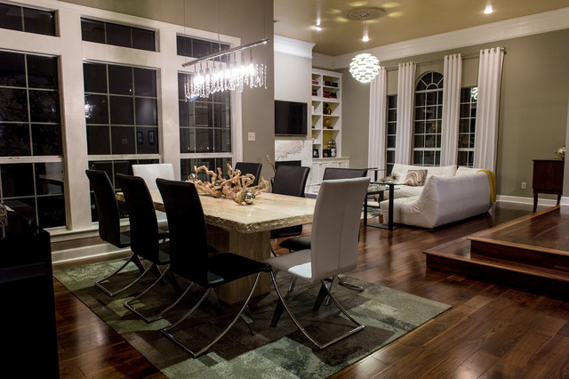 Kitchen/dining room combo - mid-sized contemporary dark wood floor kitchen/dining room combo idea in New Orleans with gray walls and no fireplace