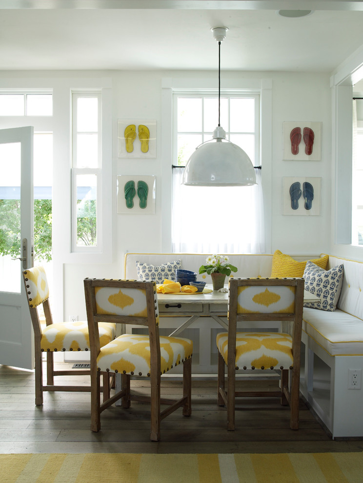 Beach style medium tone wood floor dining room photo in Jacksonville with white walls