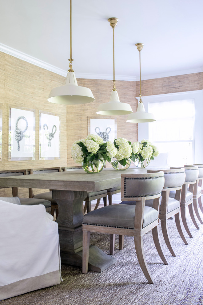Inspiration for a large transitional enclosed dining room remodel in New York with beige walls