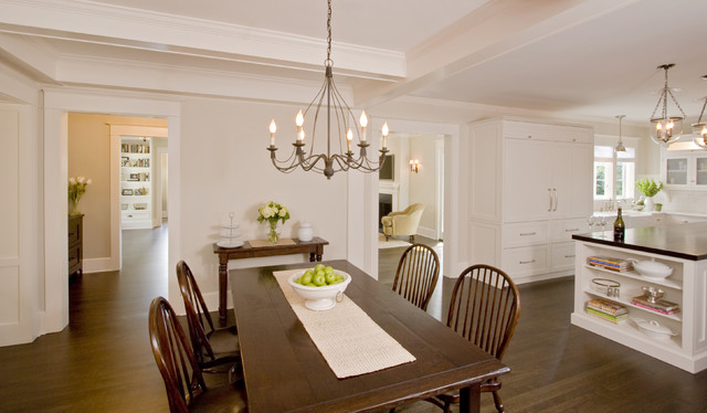 Example of a large classic dark wood floor kitchen/dining room combo design in New York with beige walls