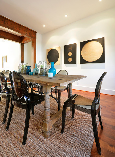Eclectic dark wood floor dining room photo in Austin with white walls