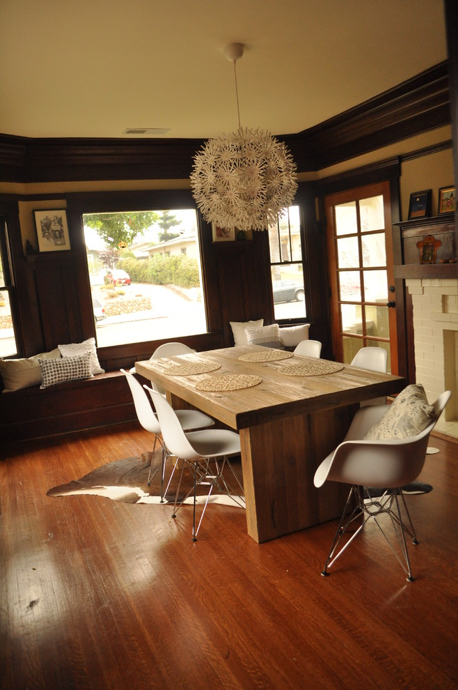 Dining room - transitional dark wood floor dining room idea in San Diego with beige walls