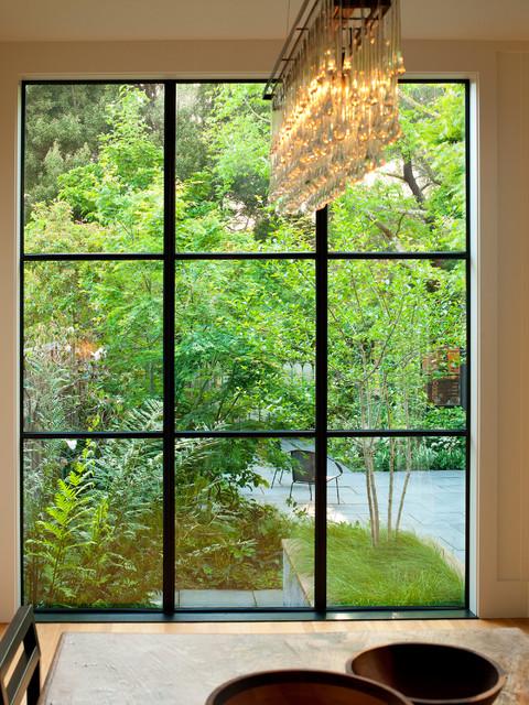 Steel windows overlooking garden eclectic dining room for Garden room windows