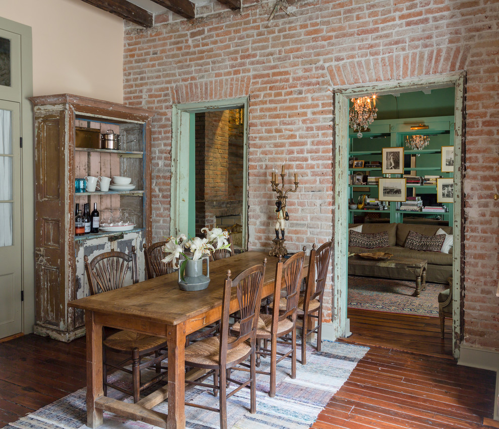 Example of an eclectic dark wood floor kitchen/dining room combo design in New Orleans