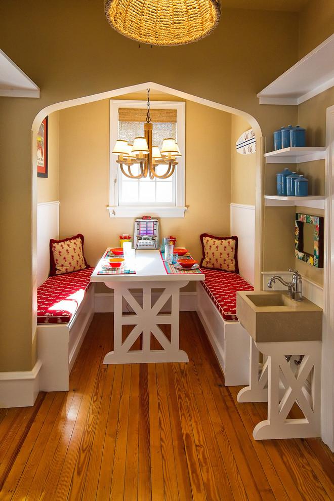 Dining room - mediterranean medium tone wood floor dining room idea in Philadelphia with beige walls