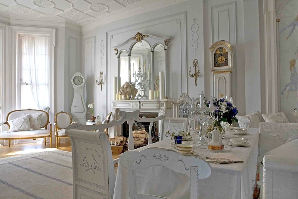 Dining room - shabby-chic style dining room idea in Other with a standard fireplace