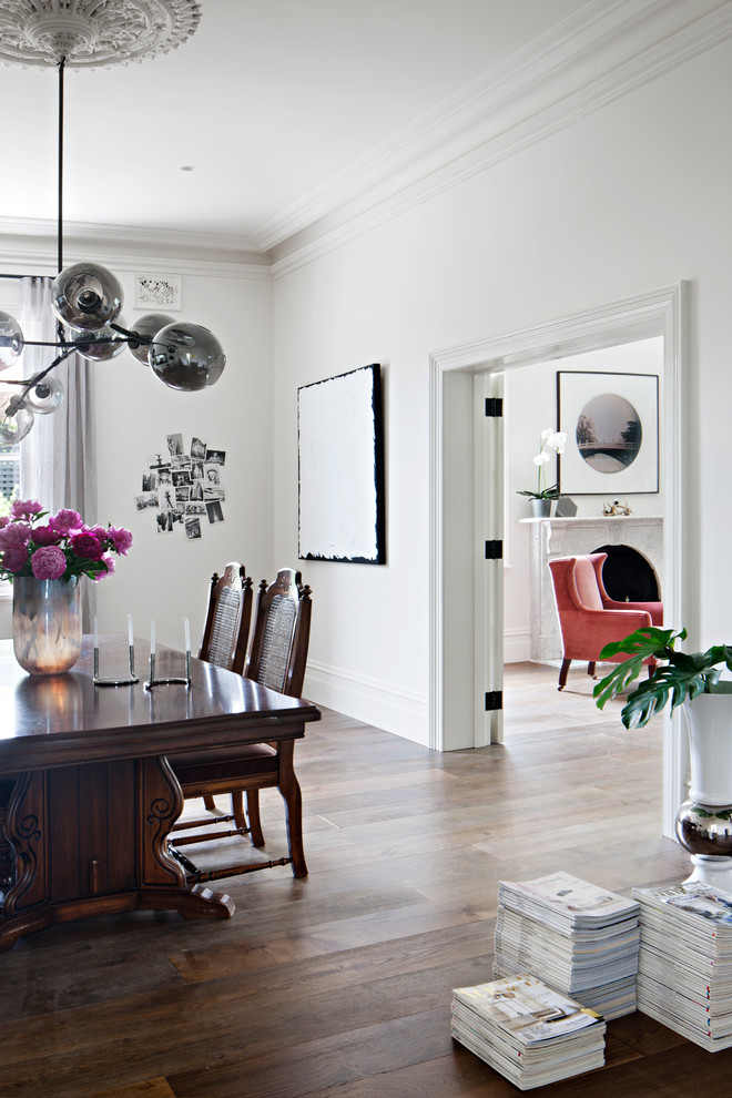 Photo of a scandi enclosed dining room in Melbourne with white walls and dark hardwood flooring.