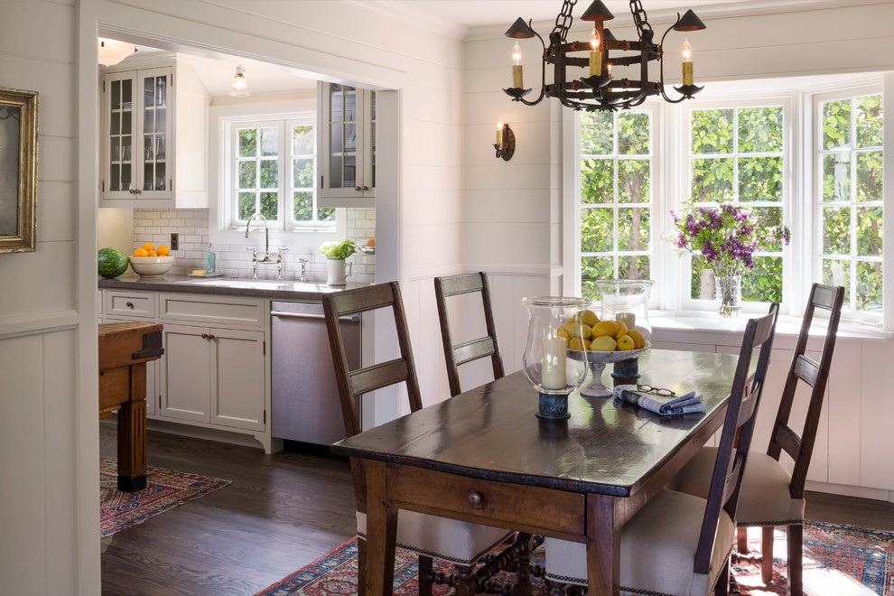 Example of a mid-sized classic dark wood floor kitchen/dining room combo design in Orange County with white walls