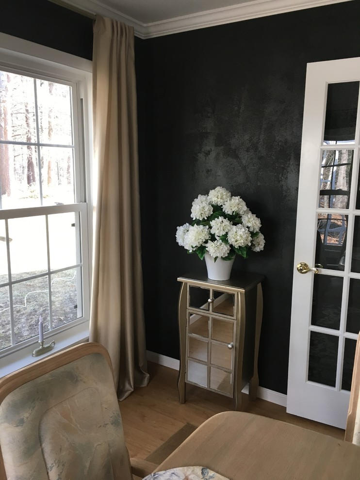 Inspiration for a modern dining room remodel in Boston with black walls