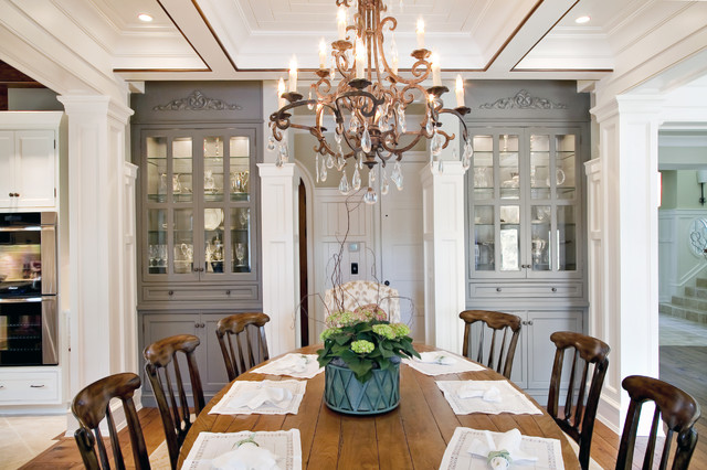 Elegant traditional dining room with custom china cabinets for Built in dining room cabinet designs