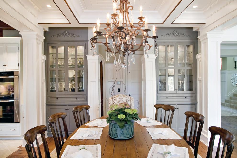 Example of a classic medium tone wood floor dining room design in Charleston